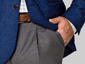 Spodnie z zakładkami a typ sylwetki. Kto może je nosić, a kto powinien ich unikać